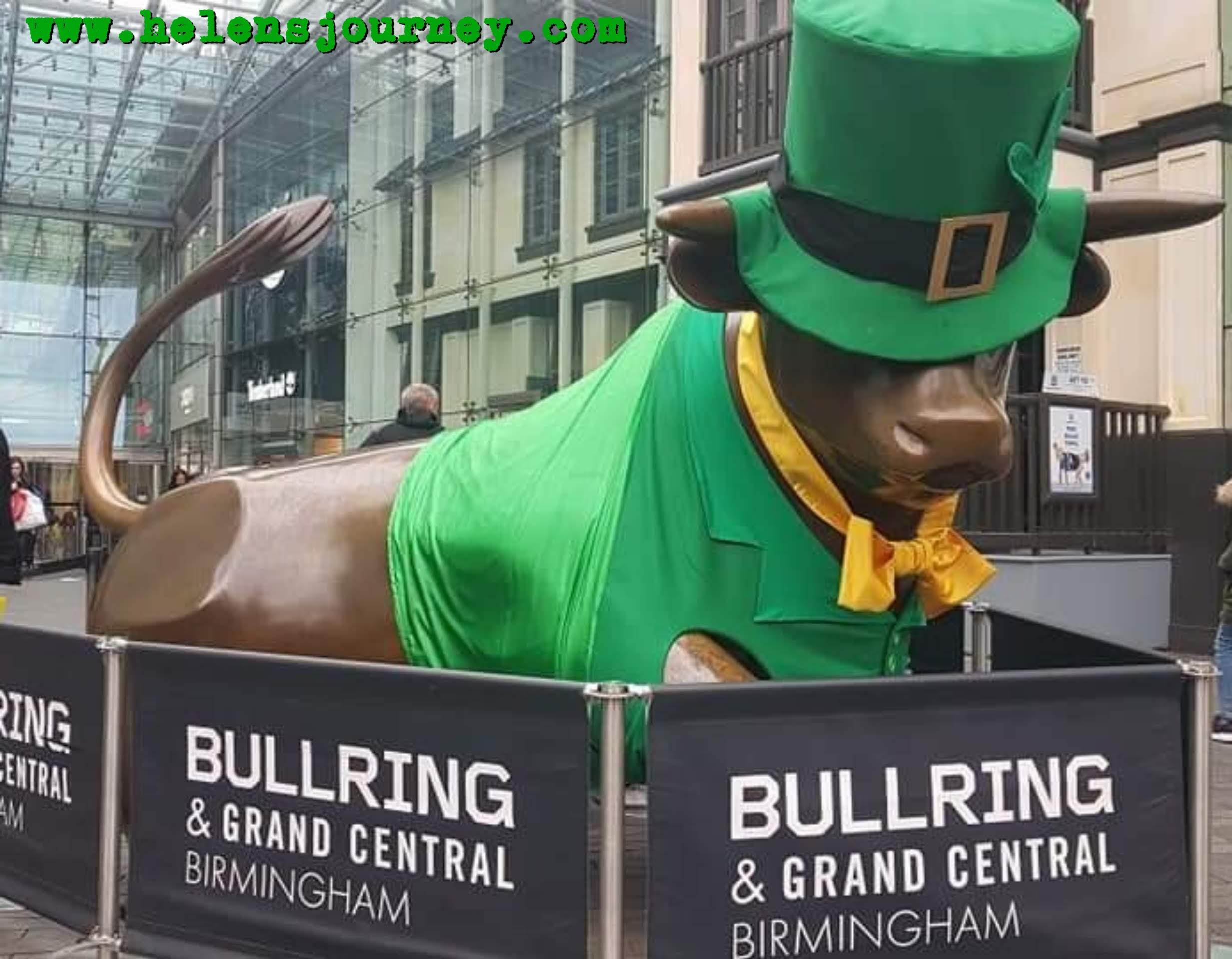 Birmingham Bull Statue at Birmingham Bullring dressed up for Saint Patricks Day as Birmingham has the 3rd biggest St Patricks Day Parade in the world