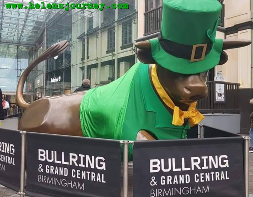 Birmingham Bull Statue at Birmingham Bullring dressed up for Saint Patricks Day as Birmingham has the 3rd biggest St Patricks Day Parade in the world